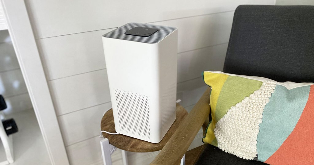 air purifier on table next to chair