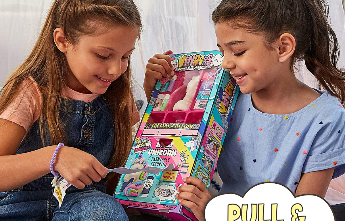 kids holding up a diy unicorn set