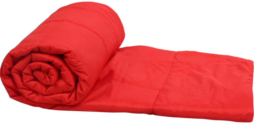 red puffy blanket rolled up