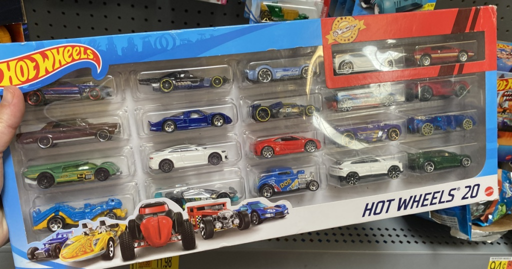 hand holding a hot wheels box of cars