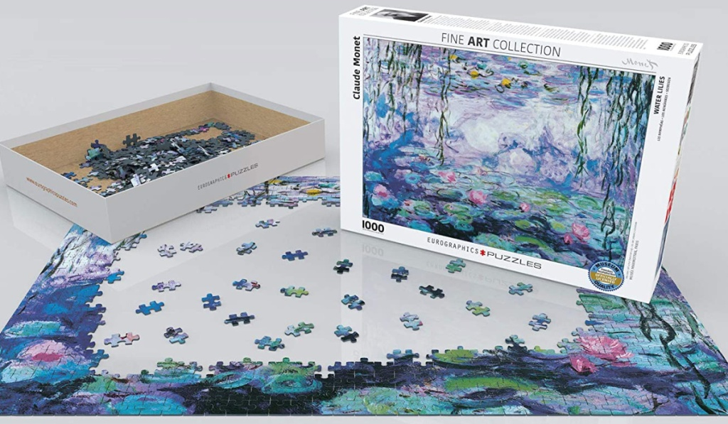 disassembled puzzle pieces with box