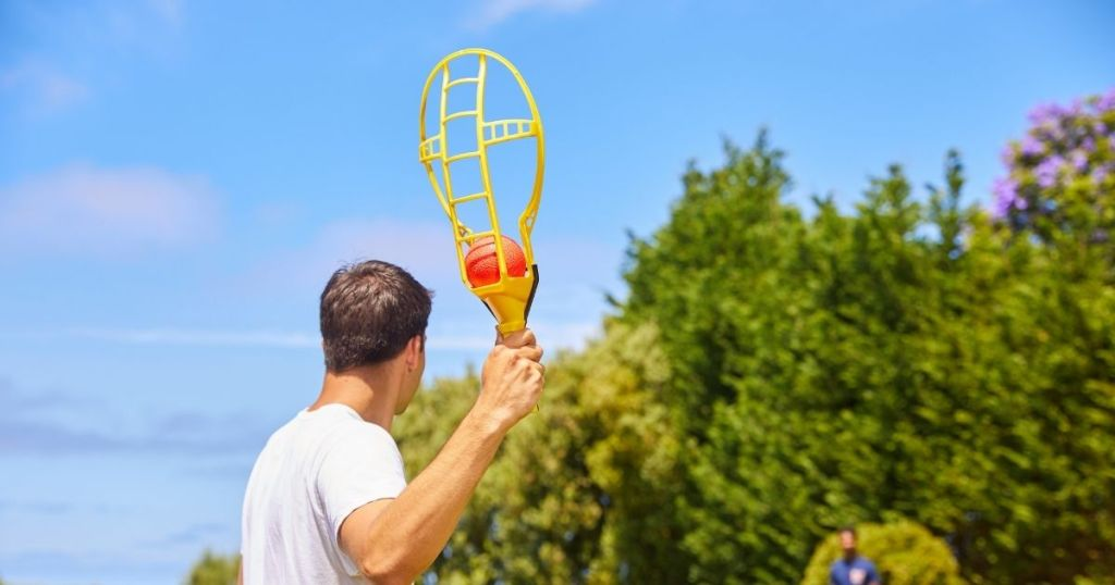 man playing with ball and raquet