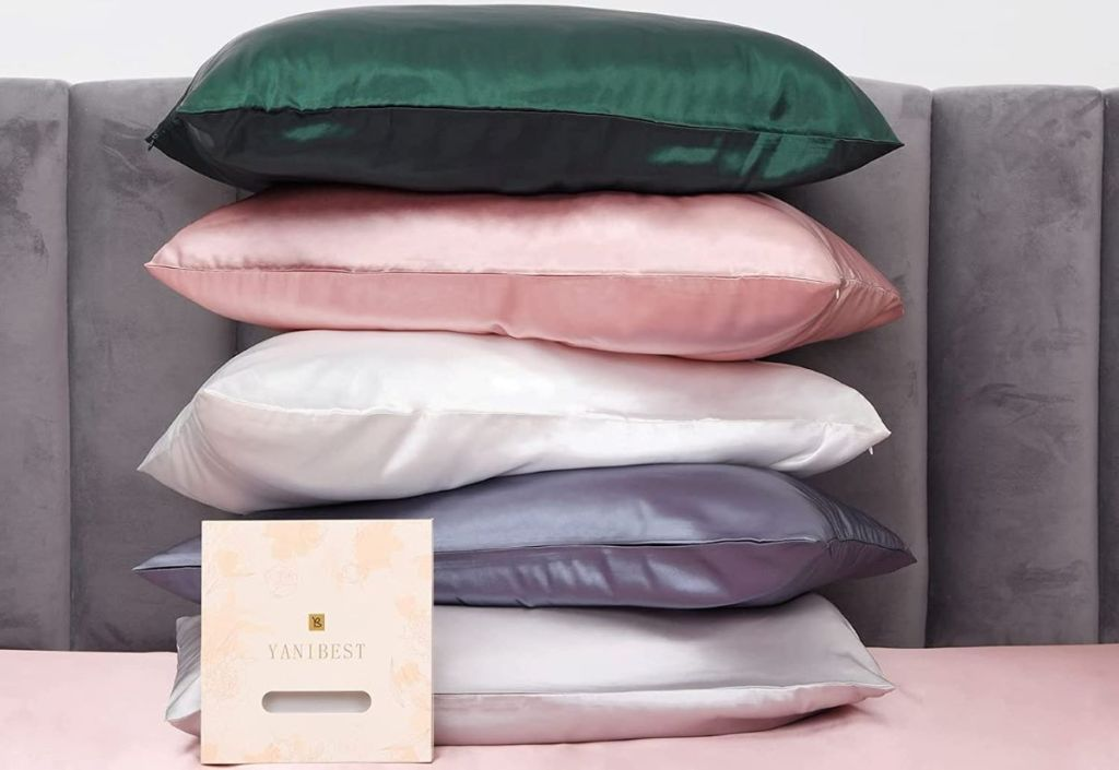 stack of pillows with satin pillowcases
