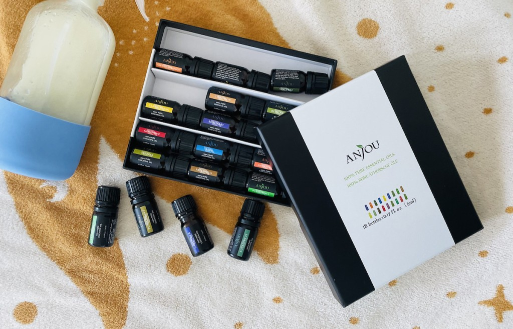 anjou essential oils kit on blanket with spray bottle