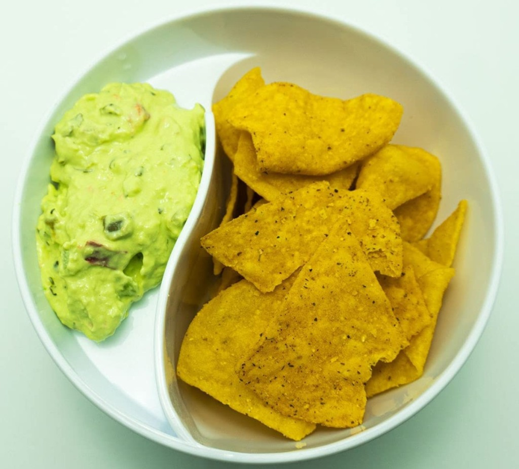 divided bowl with chips and guacamole