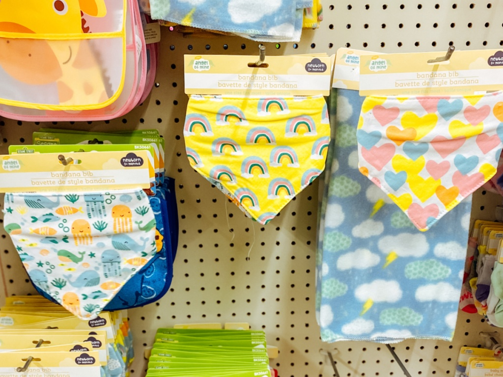 store display with baby bibs hanging on peg boards