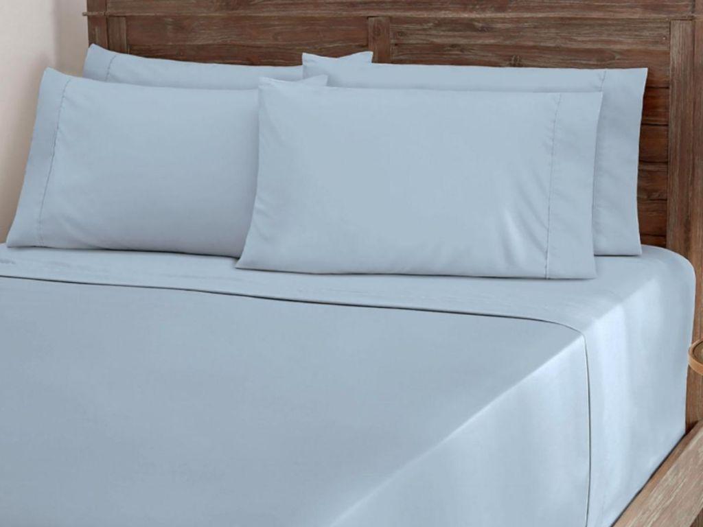 blue sheet set on bed