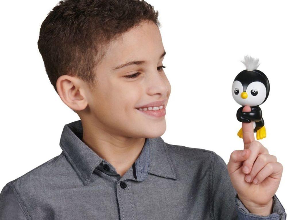 boy holding wowwee fingerling