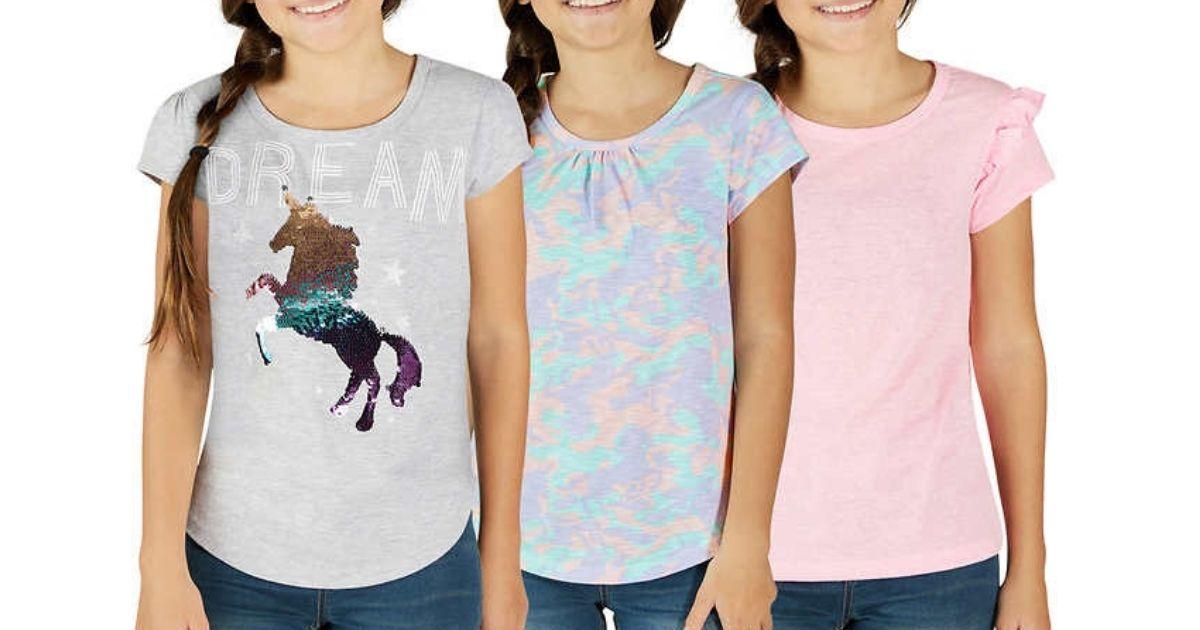 3 girls wearing unicorn themed shirts