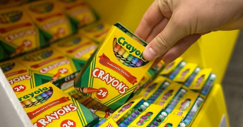 holding a box of Crayola Crayons