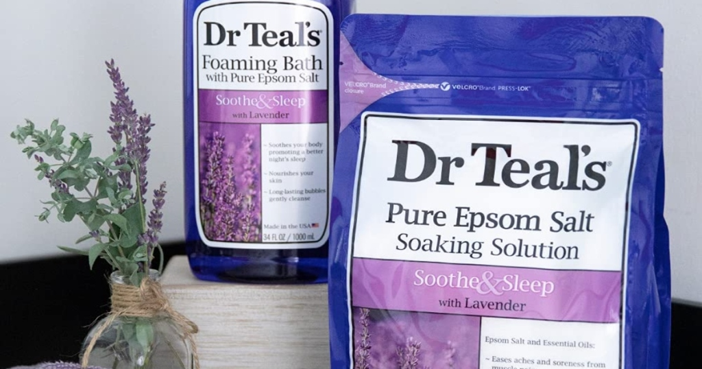 Dr. Teals Epsom Salt and bath soaking solution with a lavender plant to the left of them