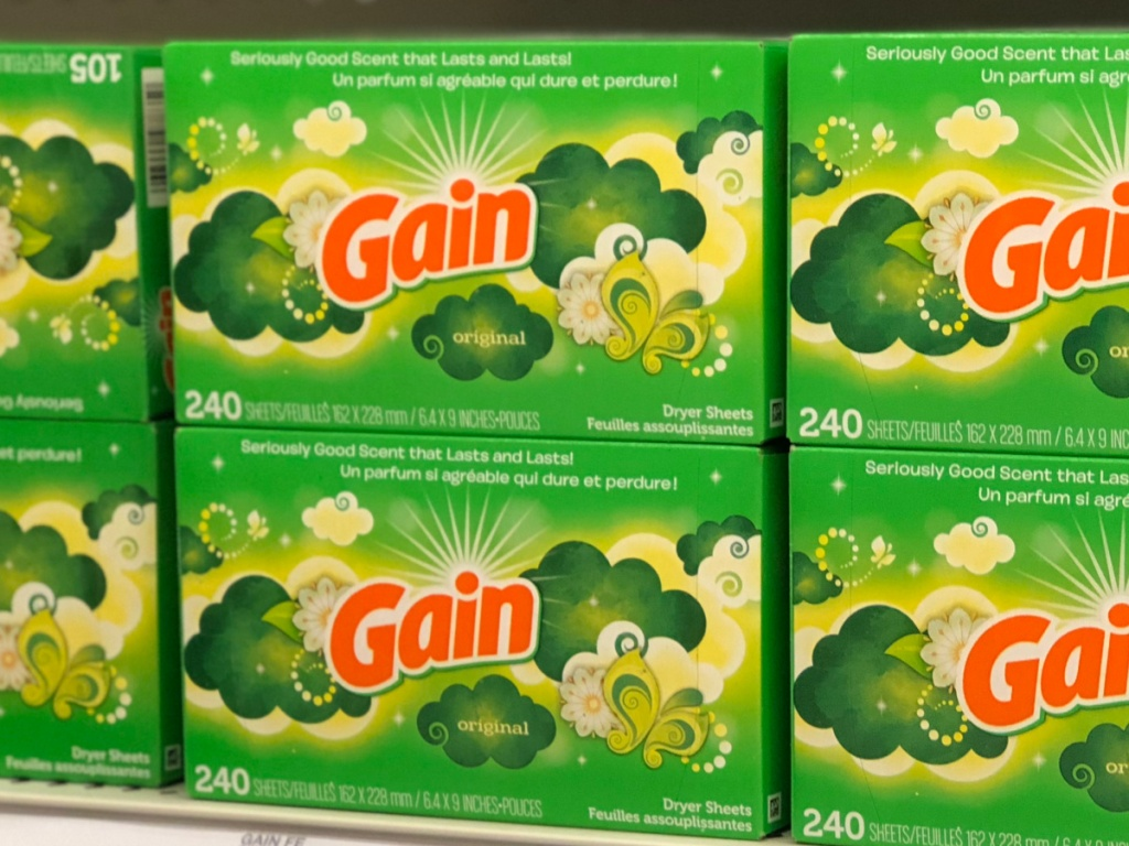 store shelves stacked with boxes of gain dryer sheets