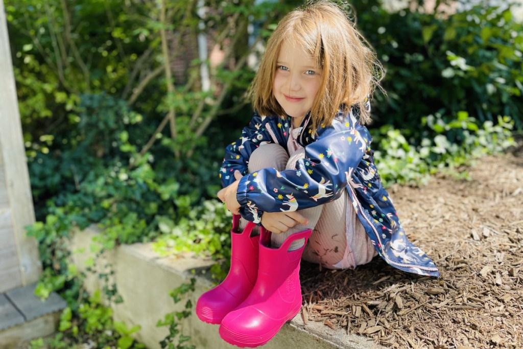 girl in pink rainboots