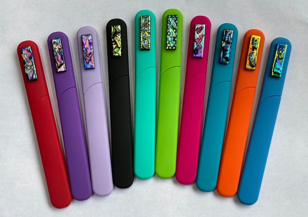 row of colorful sticks on white surface