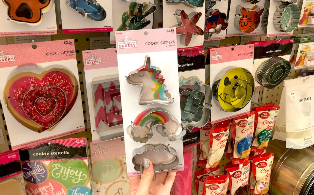 hand holding unicorn and rainbow cookie cutters in hobby lobby sale schedule aisle