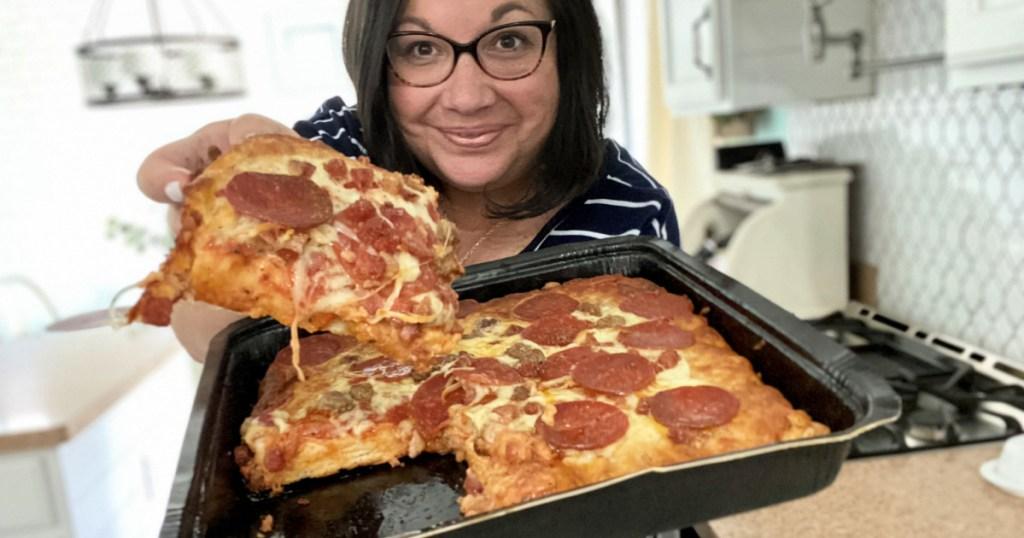 holding motor city pizza