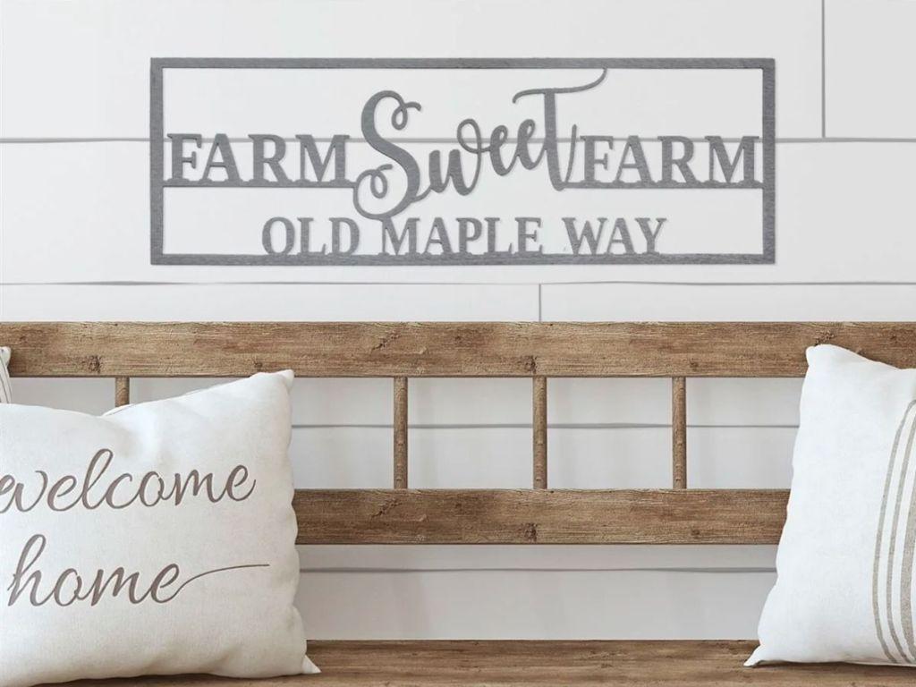 Farm Sweet Farm sign above bench