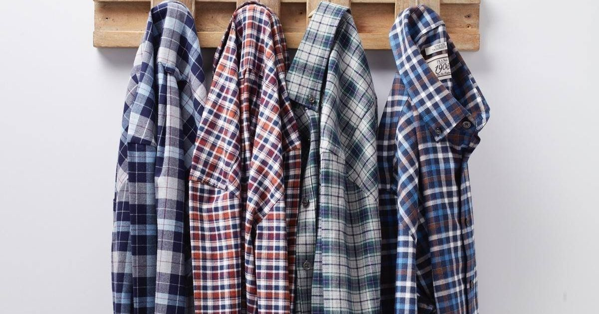 plaid shirts hanging on hooks