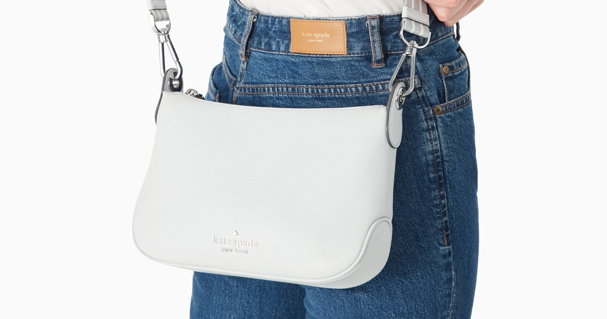Small Kate Spade Rosie bag hanging on the back of a person wearing jeans