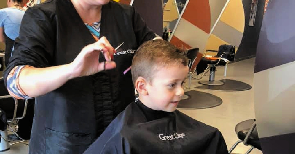 kid getting a haircut at great clips