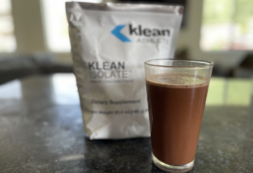 klean athlete protein powder in glass