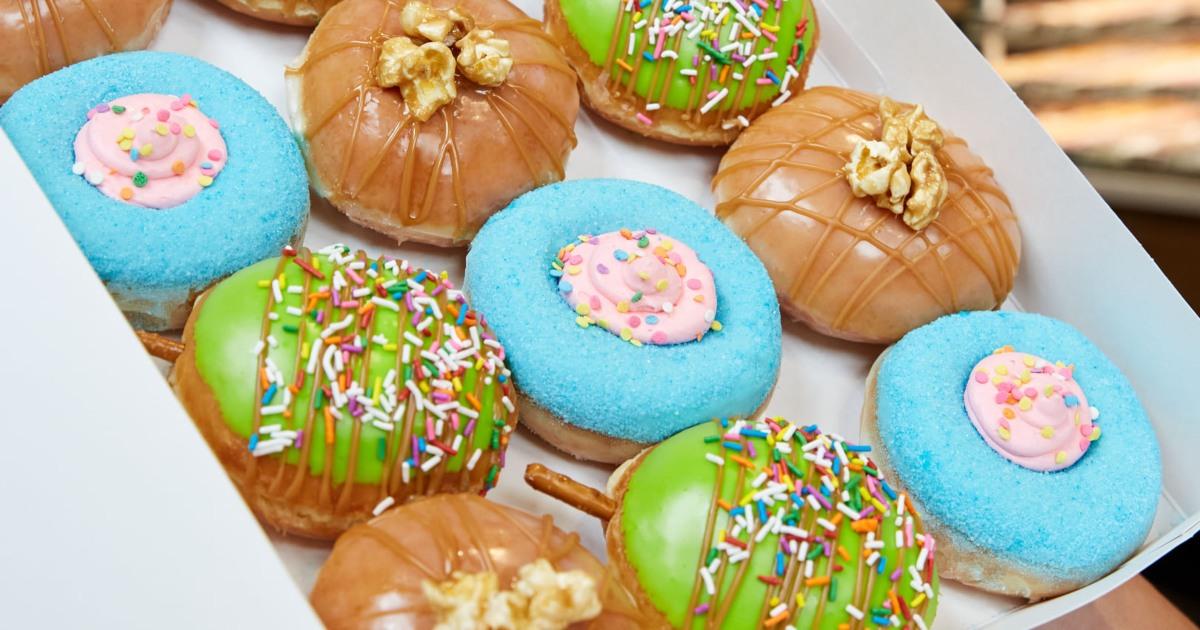 holding a box of Krispy Kreme carnival doughnuts