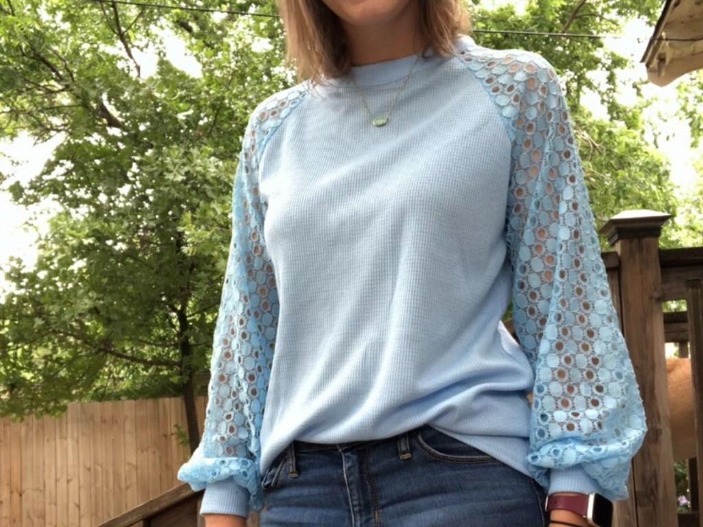 woman wearing blue lace sleeve shirt
