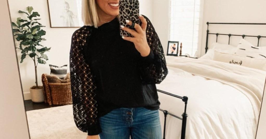 woman taking selfie in bedroom