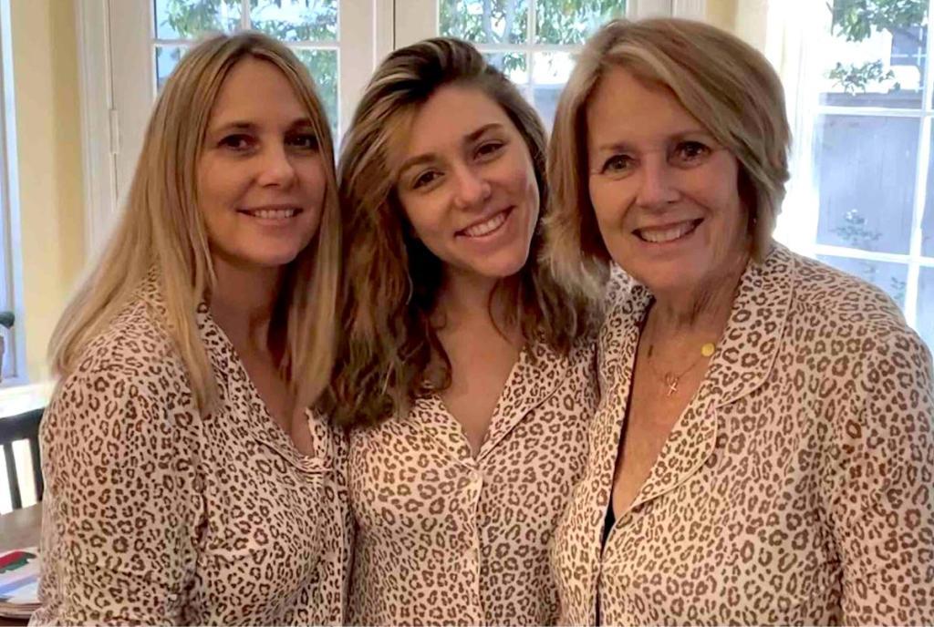 three women wearing leopard pajamas