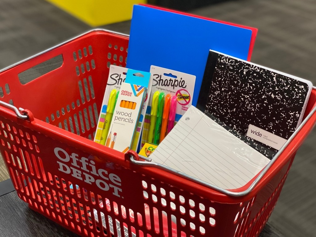 school supplies in red shopping basket