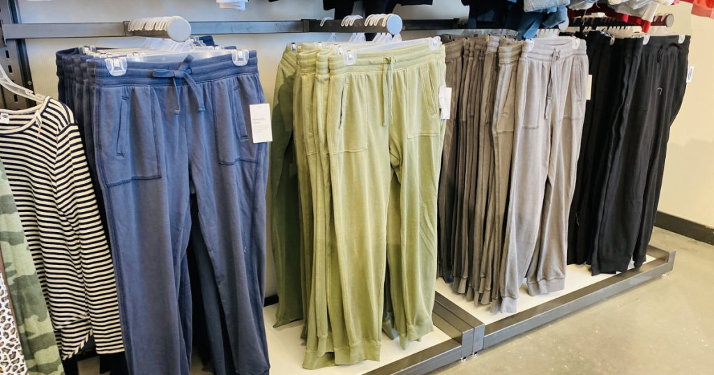 old navy joggers in store hanging up