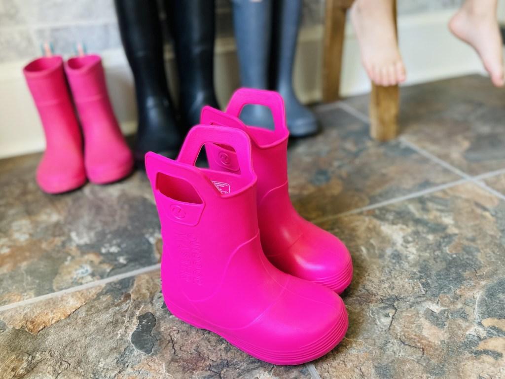 pink rainboots in mudroom