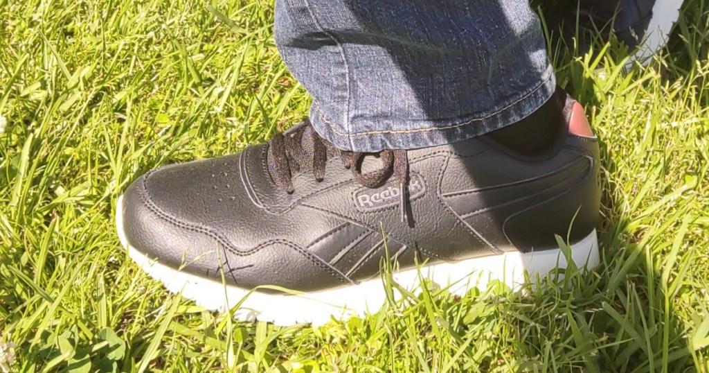 reebok sneakers in grass