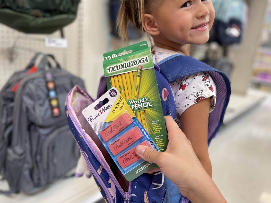 adding school supplies to backpack