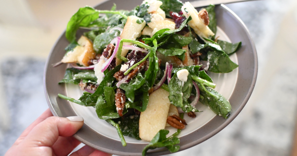 spinach pear salad with goat cheese on plate
