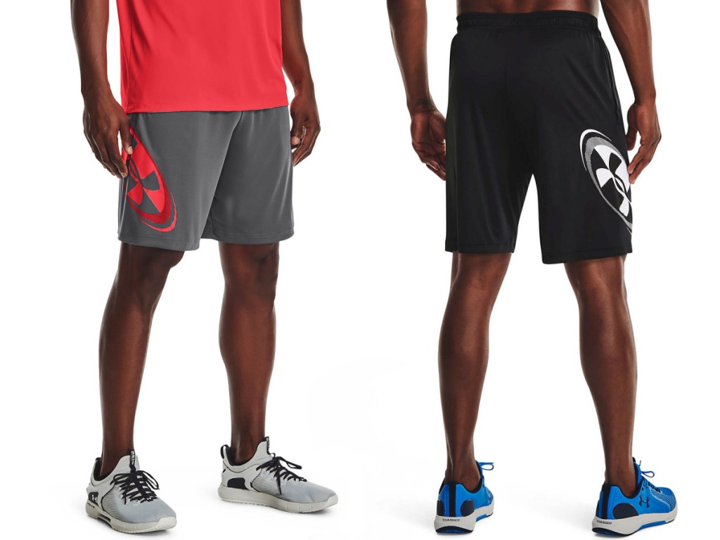 men wearing gray/red and black/white Under Armour shorts