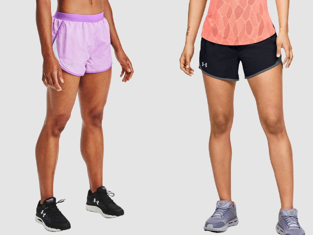 women wearing pink and black under armour shorts