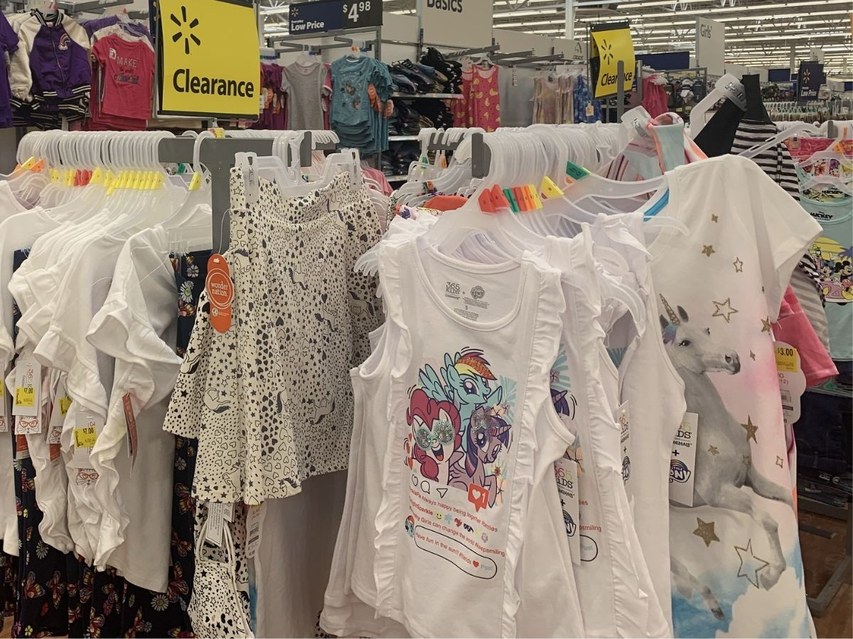 girls tees and skirts hanging on clearance rack in store