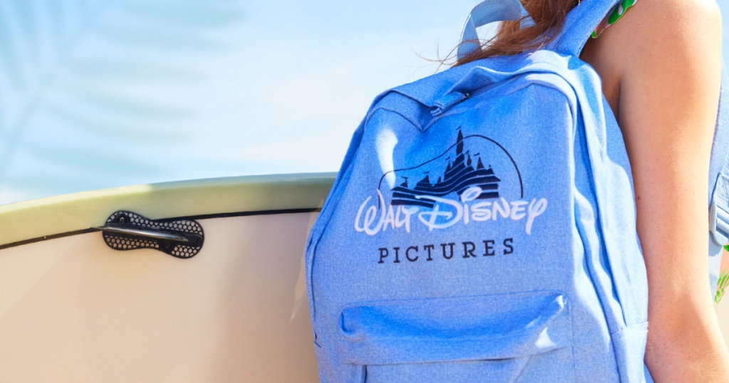 person wearing a Disney backpack