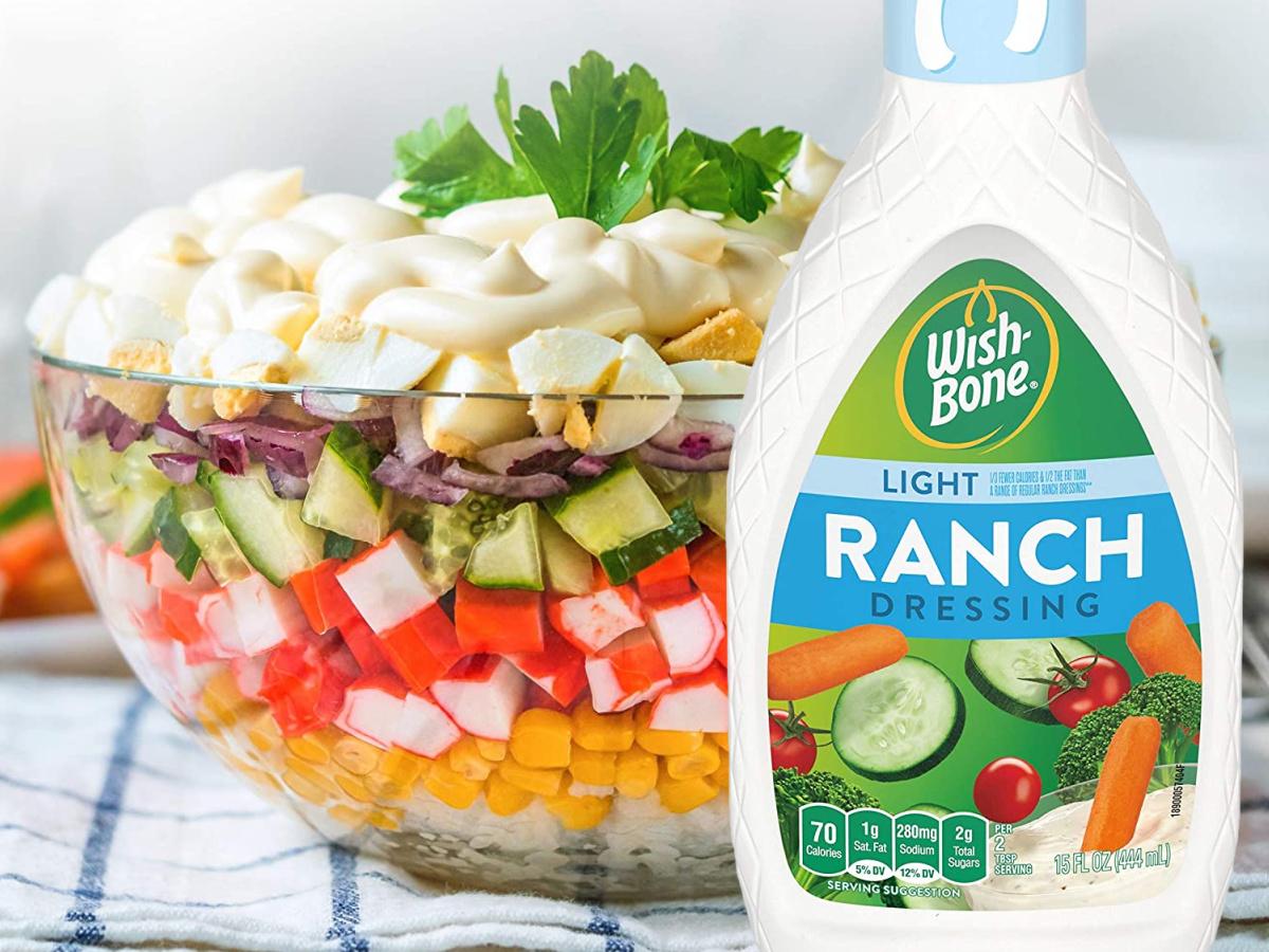 bottle of salad dressing in front of salad
