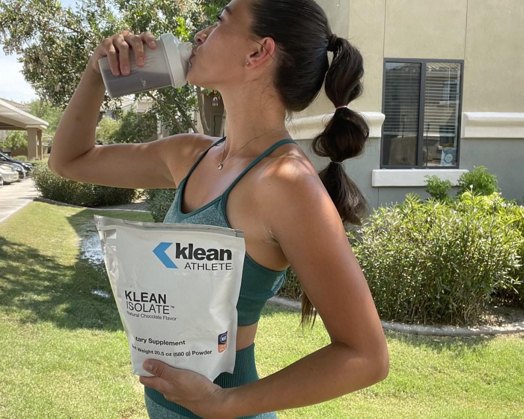 woman drinking klean athlete drink
