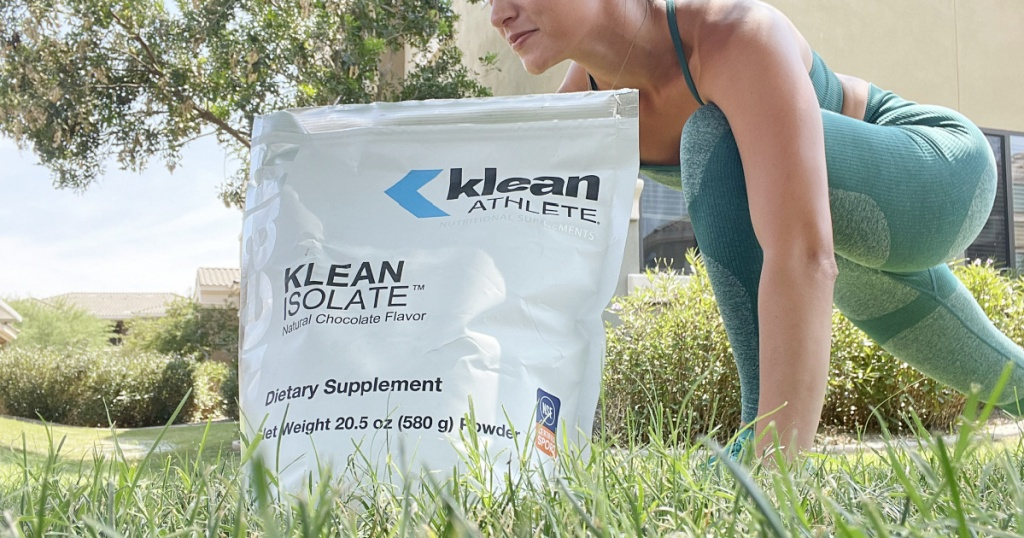 woman in grass with protein powder