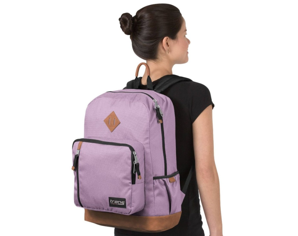 woman wearing pink backpack