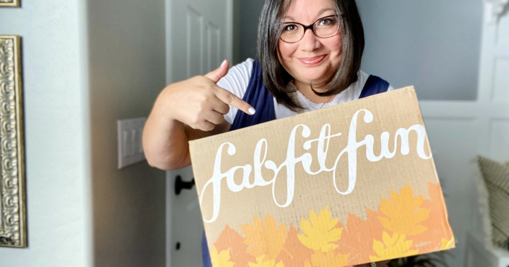 woman pointing to fall fab fit fun box