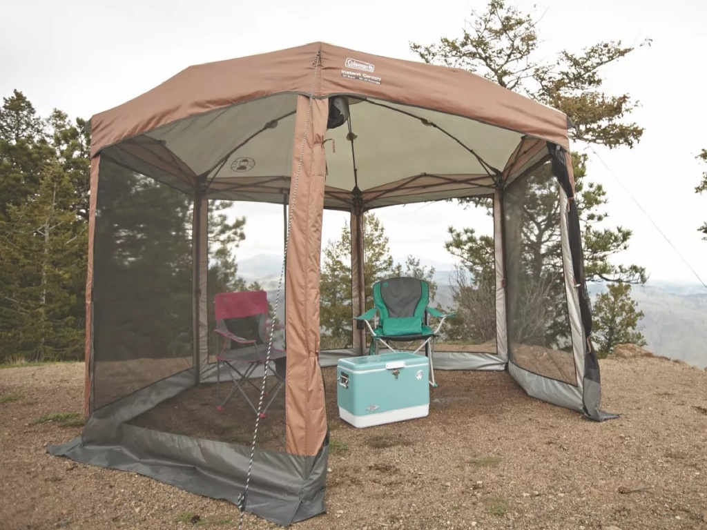 brown screened tent set up for camping