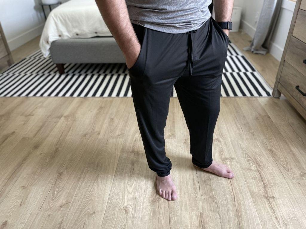 man wearing black joggers