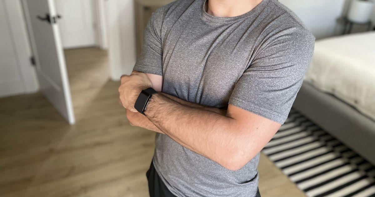 man wearing gray tee
