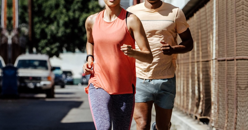 man and woman running wearing asics apparel