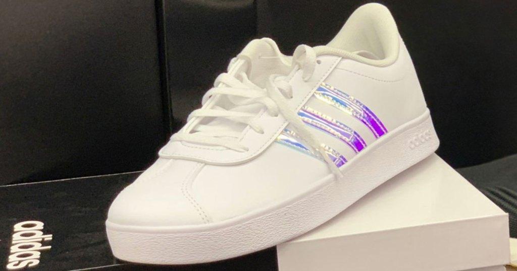 white adidas shoe with three metallic stripes