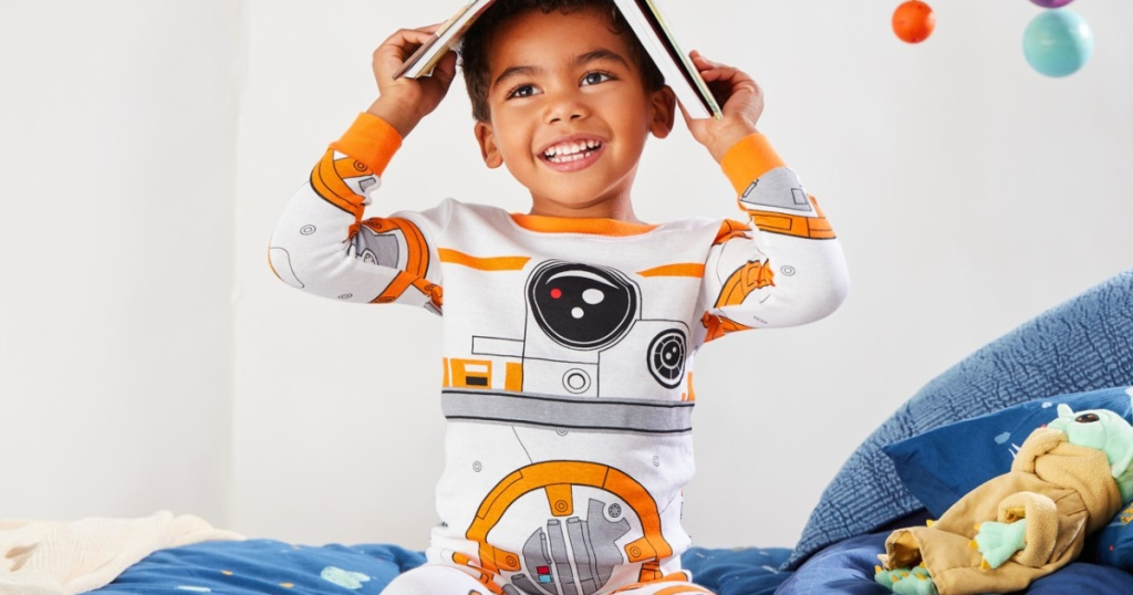 boy wearing star wars BB8 pajamas